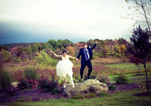 Bride-and-Groom-Jumping-Off-Rock