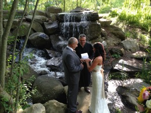 Couple-with-Priest-by-Waterfall